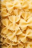 Raw pasta closeup background Stock Photo