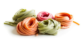 Raw pasta. Colorful raw italian pasta isolated on white background Royalty Free Stock Photography