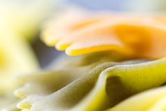 Raw pasta. Colorful raw pasta macro background, excellent as a Powerpoint background or as a unique wallpaper Royalty Free Stock Photo