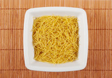 Raw pasta in a dish Stock Photo