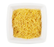 Raw pasta in a dish Royalty Free Stock Image