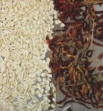 Raw pasta and dried chillies. In Apulia, Italy stock photos