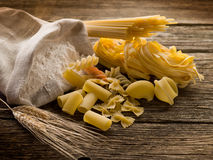 Raw pasta with ears and flour Royalty Free Stock Image