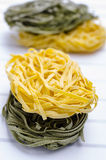 Raw  pasta. Raw egg and spinach pasta Stock Images