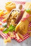 Raw pasta farfalle spaghetti penne tagliatelle. italian cuisine Royalty Free Stock Images