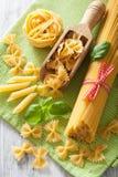 Raw pasta farfalle spaghetti penne tagliatelle. italian cuisine Stock Photography