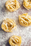 Raw pasta and flour. On table Stock Images