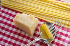 Pasta and parmesan cheese Stock Images