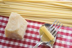 Pasta and parmesan cheese Stock Photos