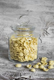 Raw pasta in a glass jar Royalty Free Stock Images