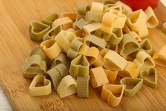 Raw pasta hearts hape. Ready for cooking Royalty Free Stock Photos