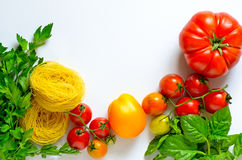 Raw pasta herbs and tomatoes Royalty Free Stock Image