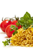 Raw Pasta with Herbs and Tomatoes Stock Photo