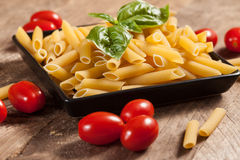 Raw pasta with ingredients. Royalty Free Stock Image