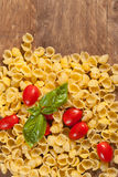 Raw pasta with ingredients. Royalty Free Stock Photo