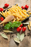 Raw pasta with ingredients. Stock Photo