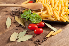 Raw pasta with ingredients. Royalty Free Stock Images