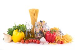 Raw pasta and ingredients Stock Photos