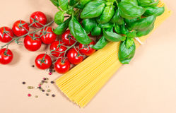Raw pasta and ingredients for pasta with tomatoes and basil. Raw pasta and ingredients for pasta with tomatoes, basil and pepper Stock Photography