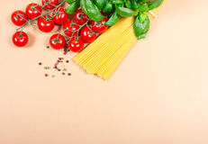 Raw pasta and ingredients for pasta with tomatoes and basil. Raw pasta and ingredients for pasta with tomatoes, basil and pepper Stock Images