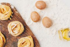 Raw pasta and ingredients Stock Images