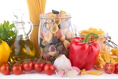 Raw pasta and ingredients Stock Image
