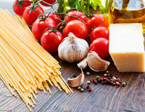 Raw pasta ingridients. Raw pasta, tomatoes and spices Stock Photos