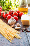 Raw pasta ingridients. Raw pasta, tomatoes and spices Royalty Free Stock Photos