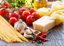 Raw pasta ingridients. Raw pasta, tomatoes and spices Stock Photo