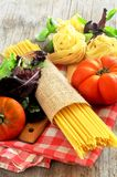 Raw pasta italian culinary art Royalty Free Stock Images