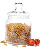 Raw pasta in jar isolated Stock Images