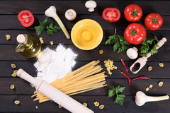 Raw pasta, kitchen table. Top view Stock Photography