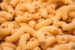 Raw pasta macaroni. Italian raw pasta macaroni background Royalty Free Stock Image