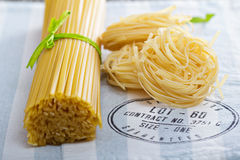Raw pasta on a napkin. Linguine and pasta nests Royalty Free Stock Photography