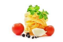 Raw pasta nest. On white background Royalty Free Stock Image