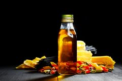 Raw pasta and oil Royalty Free Stock Photo