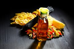 Raw pasta and oil Royalty Free Stock Photos