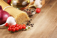 Raw pasta, oil and spices Royalty Free Stock Images