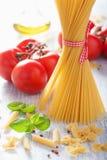 Raw pasta olive oil tomatoes. italian cuisine Stock Photography