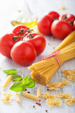 Raw pasta olive oil tomatoes. italian cuisine Royalty Free Stock Photography