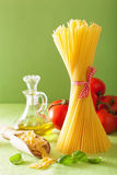 Raw pasta olive oil tomatoes. italian cuisine Royalty Free Stock Photos
