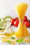 Raw pasta olive oil tomatoes. italian cuisine Stock Image