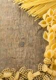 Raw Pasta On Wood Background Stock Image