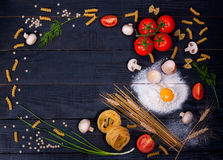 Raw pasta and other ingredients Royalty Free Stock Photo