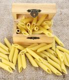 Raw Pasta , Penne. In a box Royalty Free Stock Photography