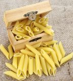 Raw Pasta , Penne. In a box Royalty Free Stock Photo
