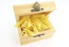 Raw Pasta , Penne. In a box on White Back Ground Royalty Free Stock Photography