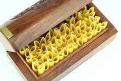 Raw Pasta , Penne. In a box on White Back Ground Stock Photography