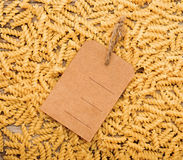 Raw pasta and price tag Royalty Free Stock Images