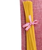 Raw pasta with ribbon on napkin Royalty Free Stock Photos